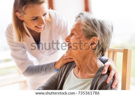 Health visitor and a senior woman during home visit. Royalty-Free Stock Photo #735361786