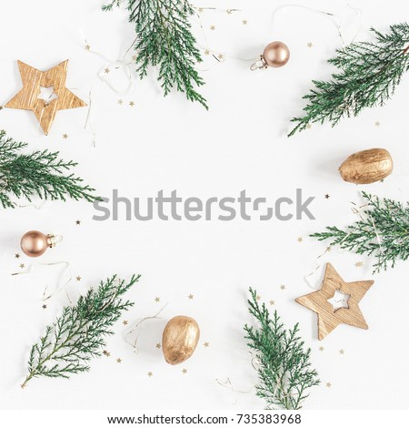 Christmas composition. Christmas frame made of conifer branches, balls, golden decorations on white background. Flat lay, top view, copy space, square. #735383968