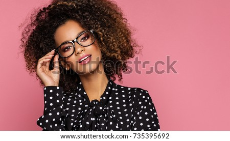 Beautiful black woman model wear black shirt in peas and holding glasses  #735395692
