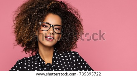Beautiful black woman model wear glasses and black shirt in peas Royalty-Free Stock Photo #735395722