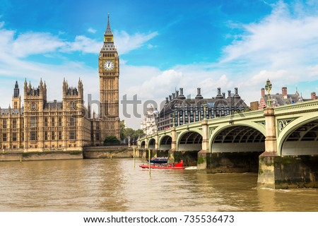 The Big Ben, the Houses of Parliament and Westminster bridge in London in a beautiful summer day, England, United Kingdom Royalty-Free Stock Photo #735536473