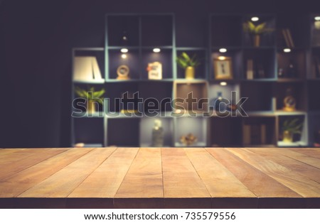 Real wood table top texture on dark room interior design background.For create product display or design key visual layout
