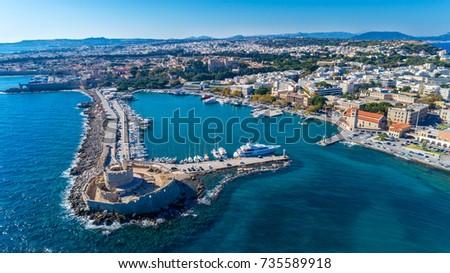 Aerial drone photo of Mandraki Harbor in Rhodes, Greece #735589918