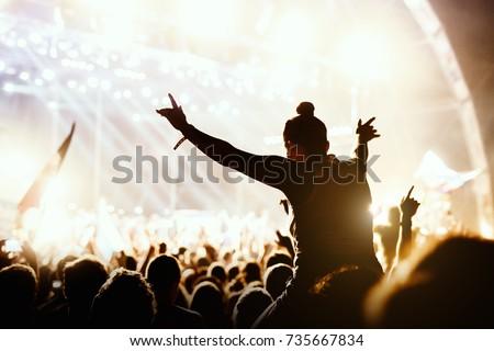Girl enjoying the outdoor music festival concert. Royalty-Free Stock Photo #735667834