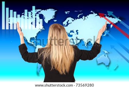 Businesswoman with hands in the air, looking at economic theme in the World #73569280