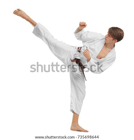 Young guy karatek with brown belt on white isolated background #735698644