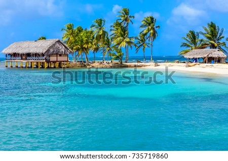 Beautiful lonely beach in caribbean San Blas island, Kuna Yala, Panama. Turquoise tropical Sea, paradise travel destination, Central America #735719860