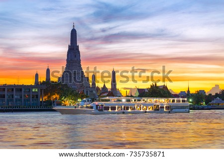 Chao Phraya River Cruise Boat with Temple of the Dawn, Wat Arun, at Sunset in Background, Horizontal #735735871