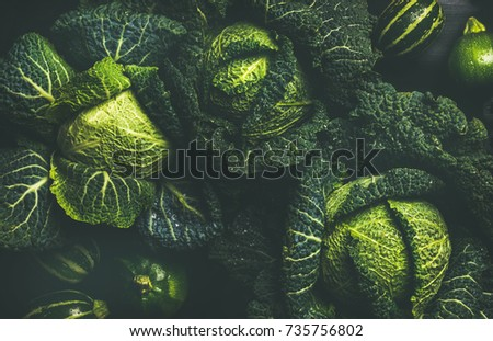Raw fresh green cabbage texture and background, top view over dark background, selective focus, horizontal composition #735756802