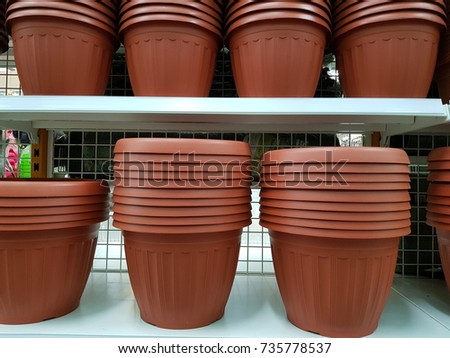 Plastic flower pot on shelf in department store #735778537