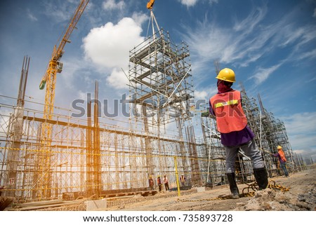 teamwork construction worker installation scaffolding in industrial construction by crane during sunset sky background over time job #735893728