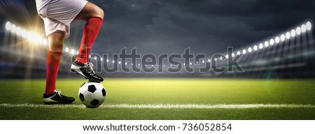 Football player in the stadium Royalty-Free Stock Photo #736052854