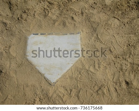 Home plate on the left with copy space on the right with sand background #736175668
