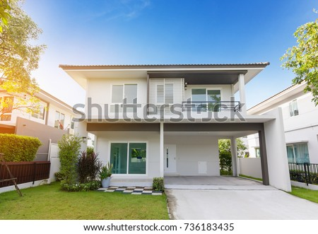 Beautiful exterior of newly home with green grass and blue sky during at sunrise.Front View of New Residential house for sale.Home For Sale,Rent,Housing and Real Estate concept. #736183435
