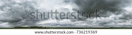 Panorama of cloudy gray sky Royalty-Free Stock Photo #736219369