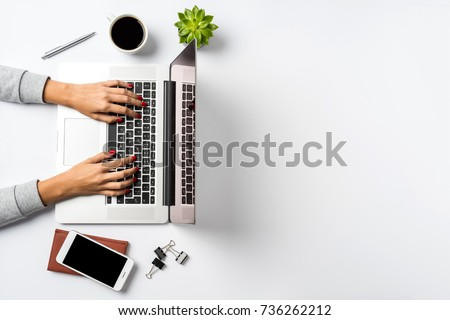 Female hands working on modern laptop. Office desktop on white background