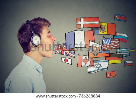 Young man learning different languages Royalty-Free Stock Photo #736268884