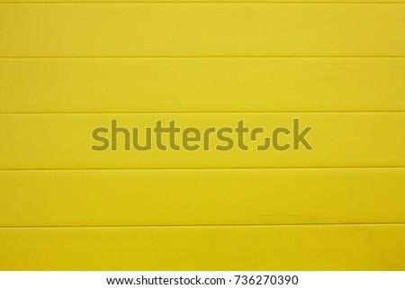 Bright yellow plastic wall #736270390