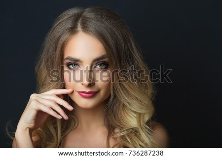 portrait of a smiling beautiful young girl with makeup and hair-dress on head on a black background #736287238