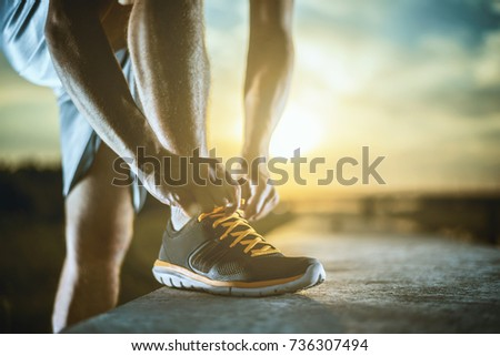 Close up shot of runner's shoes.Exercise, fitness and healthy lifestyle. #736307494