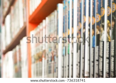 Comic books in bookshelf for background Royalty-Free Stock Photo #736318741