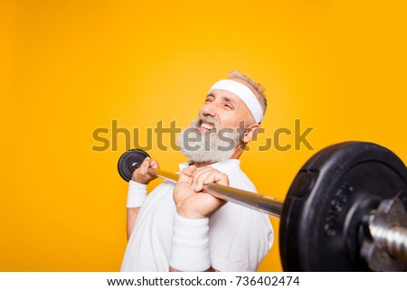 Comic, confident cool grey haired grandpa with humor grimace exercising holding equipment, lifts it up. Body care, hobby, weight loss, deadlift, powerlifting, pressure, proud lifestyle #736402474