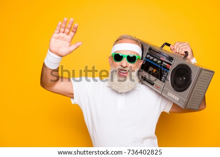 Yeah bro! What`s up? Cheerful excited aged funny sexy gangster cool grandpa dude in eyewear with bass clipping ghetto blaster recorder. Old school, swag, fooling, gym, technology, success, hip hop #736402825