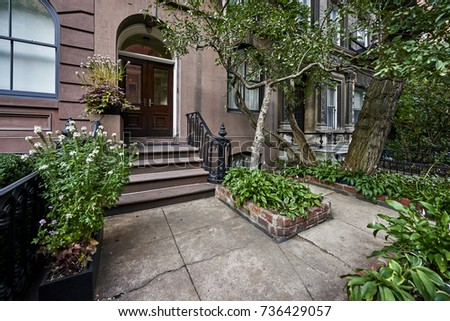 an ornate door on a brownstone building #736429057
