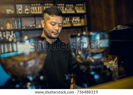 Portrait of a young Asian man Barista preparing espresso with machine at coffee shop. #736488319