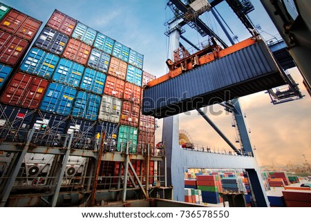 Container loading in a Cargo freight ship with industrial crane. Container ship in import and export business logistic company. Industry and Transportation concept. Royalty-Free Stock Photo #736578550