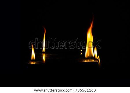 Burning fire on black background. #736581163