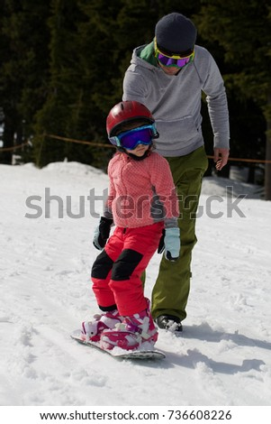 At Sunny Cold Winder Day at Mountain Ski Resort Mount Hood Meadows Oregon Father Teaching Little Daughter Snowboarding  #736608226