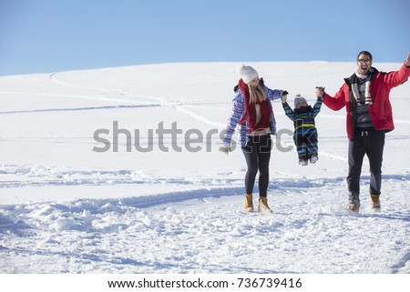 Attractive family having fun in a winter park on mountain #736739416