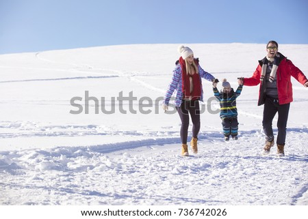 Attractive family having fun in a winter park on mountain #736742026