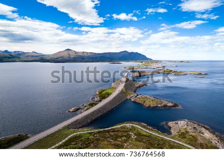 "Atlantic Ocean Road or the Atlantic Road (Atlanterhavsveien) been awarded the title as ""Norwegian Construction of the Century"". The road classified as a National Tourist Route. Aerial photography Royalty-Free Stock Photo #736764568"