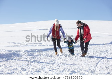 Attractive family having fun in a winter park on mountain #736800370