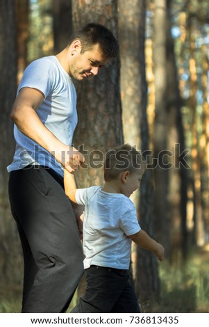 Dad and son in green park on sunny day #736813435