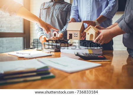 Business meetings of real estate brokers and company presidents to select a model to build a housing estate in writing and presenting to state organizations. Royalty-Free Stock Photo #736833184