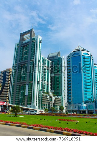 SHARJAH, UNITED ARAB EMIRATES - March 28, 2017: Crystal Plaza shopping center and other buildings of Sharjah, King Faisal street near Corniche street. #736918951