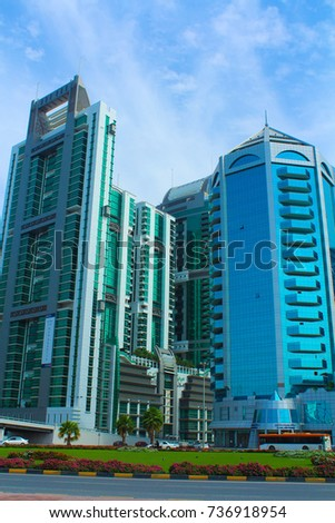 SHARJAH, UNITED ARAB EMIRATES - March 28, 2017: Crystal Plaza shopping center and other buildings of Sharjah, King Faisal street near Corniche street. #736918954