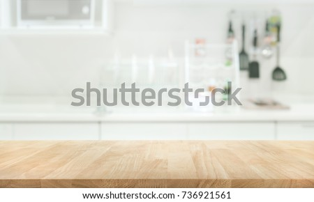 Wood table top on blur kitchen room background .For montage product display or design key visual layout.