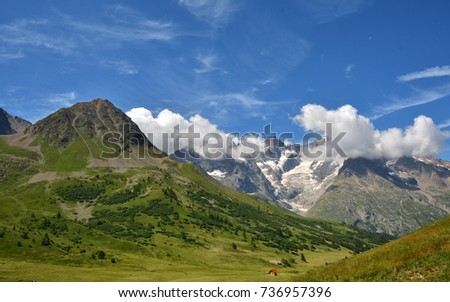 Beautiful view from Col du  Lautaret, high mountain pass in the department of Hautes-Alpes ,communication route between Grenoble and Briancon #736957396