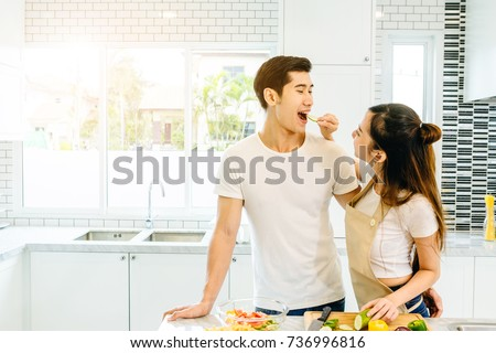Asian teen couple are helping to make dinner. And bakery together happily. On Valentine's Day in their home. #736996816