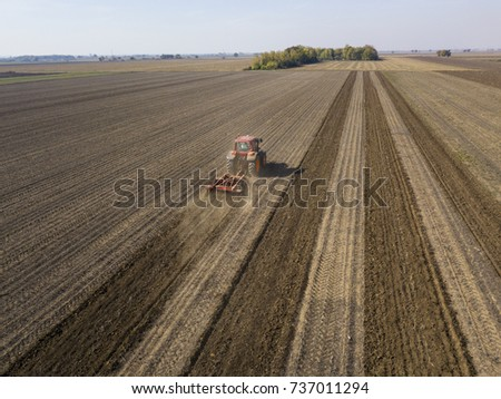 tractor working on field #737011294