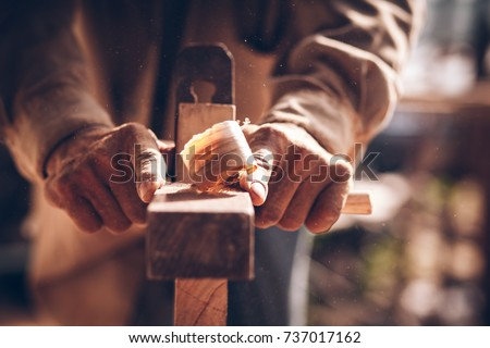 The carpenters are using spokeshave to decorate the woodwork. Royalty-Free Stock Photo #737017162