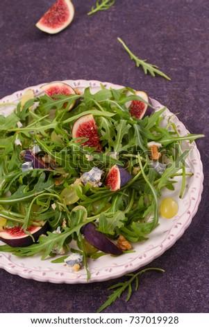 Grapes, figs, blue cheese, arugula and walnuts salad, vertical #737019928