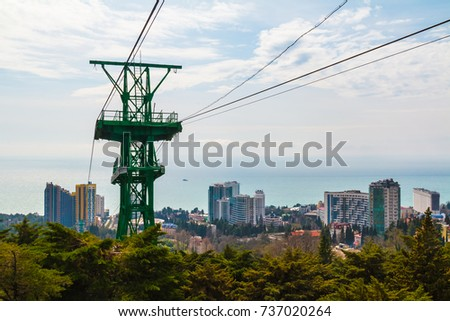 The cableway over the city on the background of the sea in sunny day, Sochi, Russia #737020264