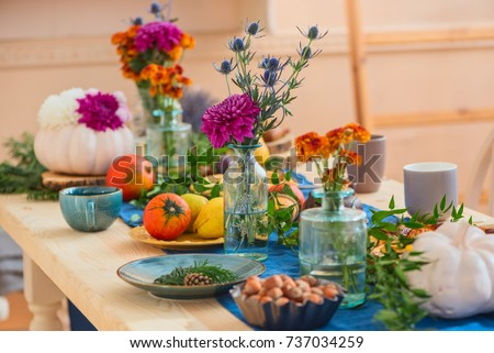Festively served autumn table, autumn food and paraphernalia, pumpkins, flowers, tea  #737034259