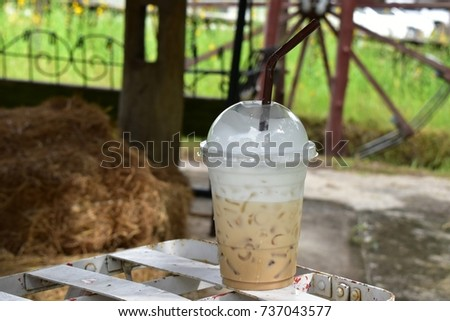Iced coffee at outside park on holiday travel. #737043577