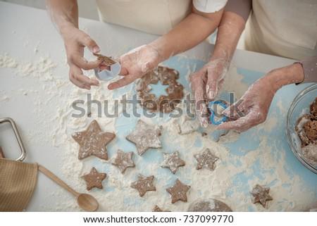 Skillful arms sculpting cookies before baking #737099770
